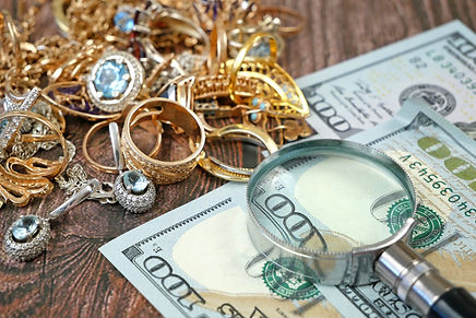 many golden and silver jewerly and money
