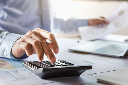 accountant working on desk using calcula