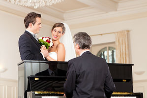 Bridal couple in front of a piano, the p
