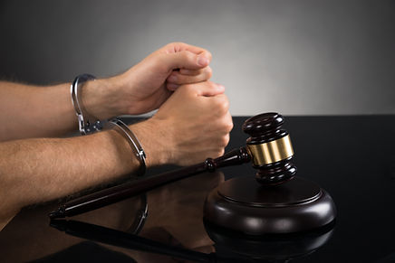 Close-up Of Person Hand In Handcuffs Wit