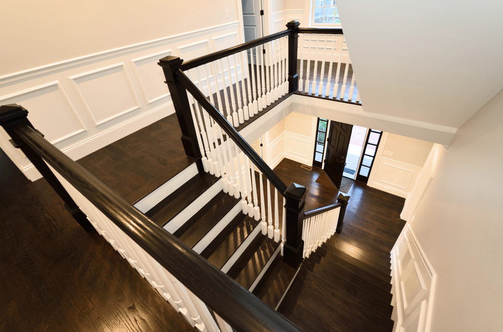Interior staircase in new home. Colonial