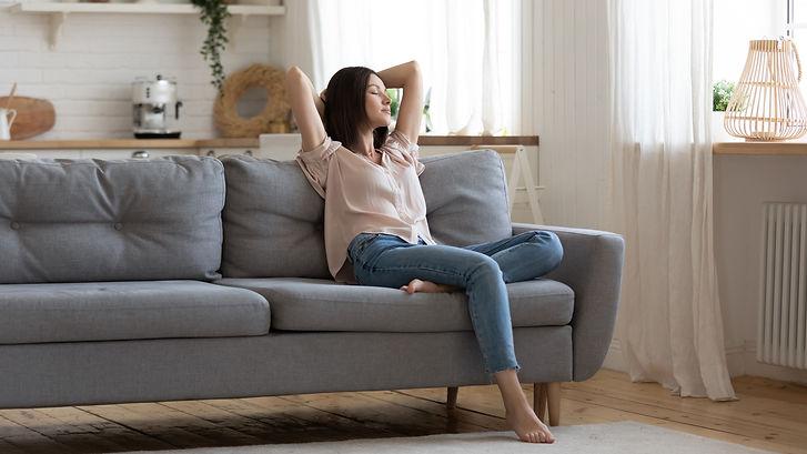 Serene lady housewife lounge sit on sofa