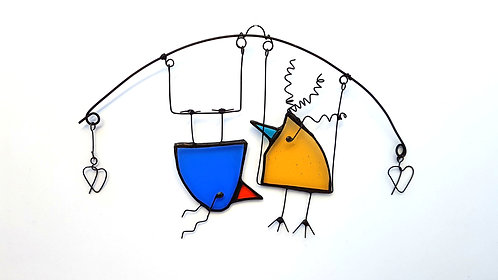 Blue and Yellow Birds on a Swing