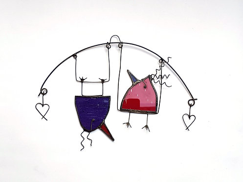 Red and Purple Birds on a Swing