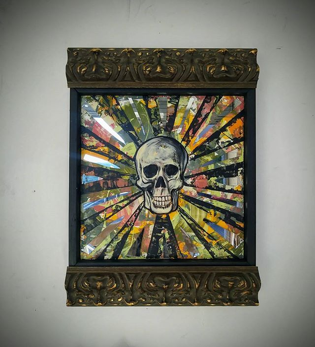 Smiling mirrored skull painting