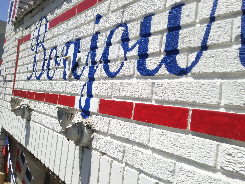 Handpainted Sign on Brick_edited