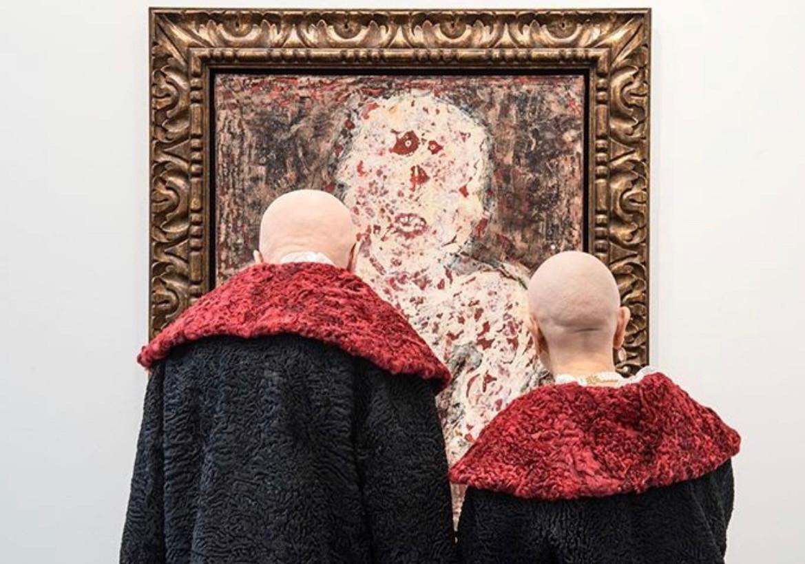 Art stars Eva and Adele admiring a Jean