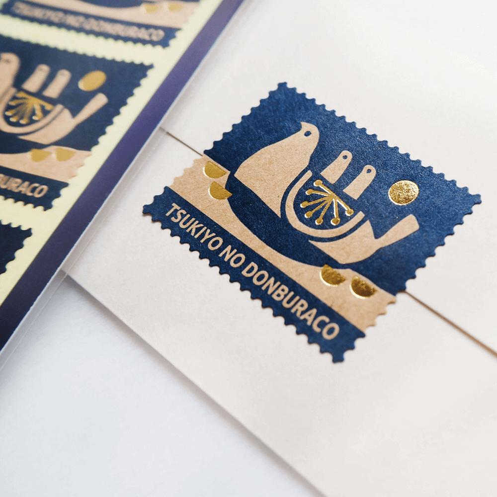 切手型箔押しシール TSUKIYO NO DONBURACO