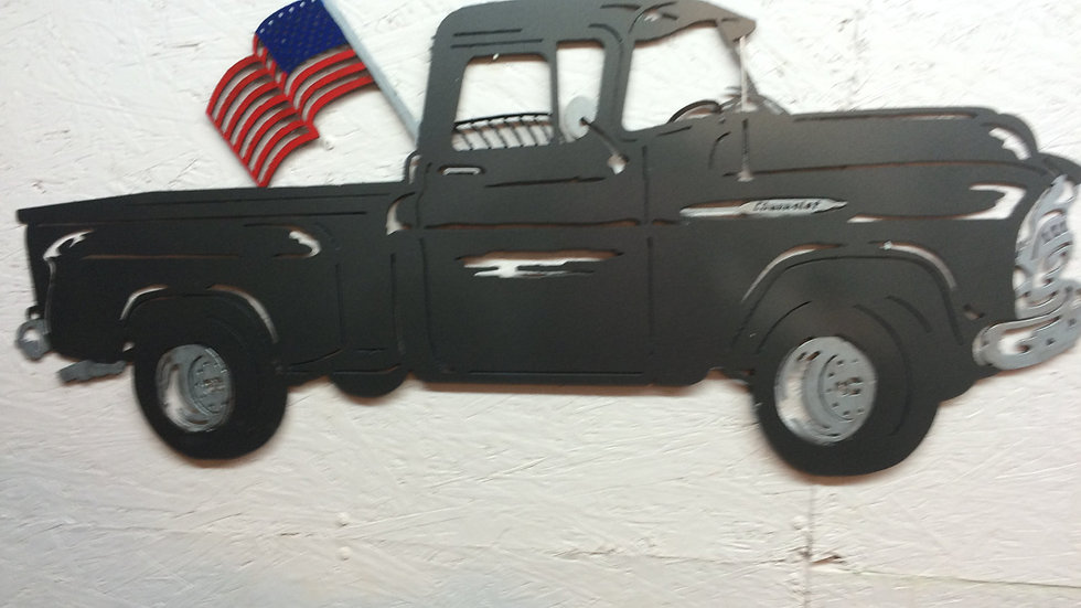 Old Chevy truck with hand painted flag