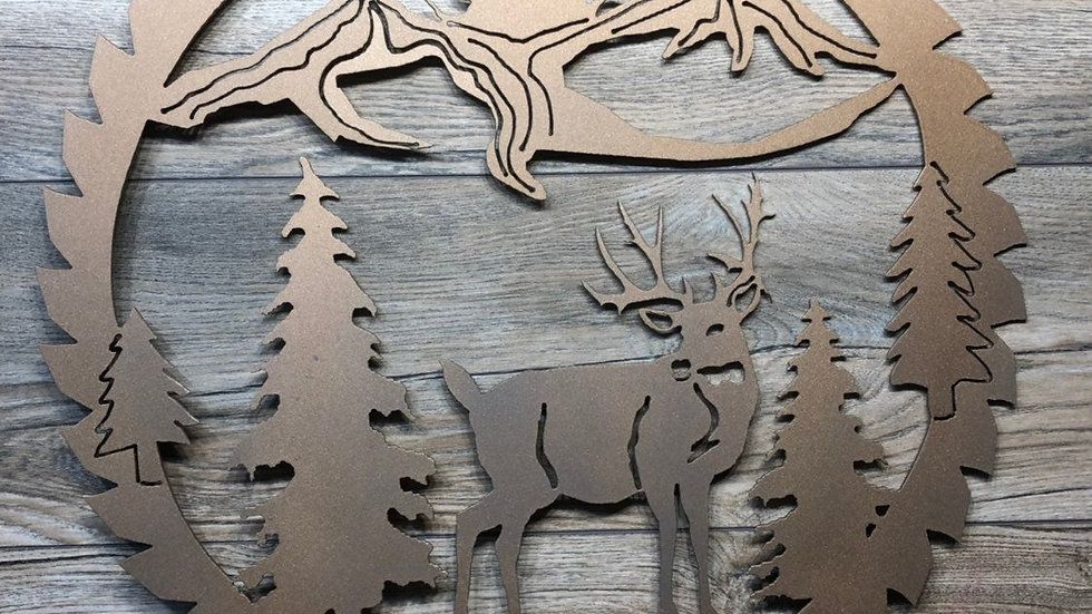 Deer mountain scene in saw blade