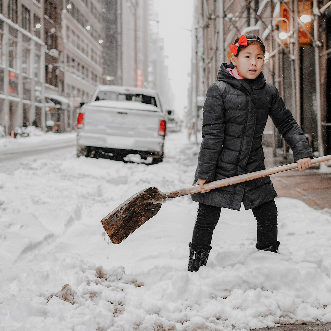 Girl Cleaning Snow