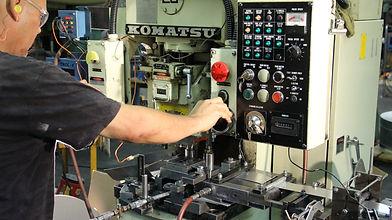 Punch press operator running progressive tooling