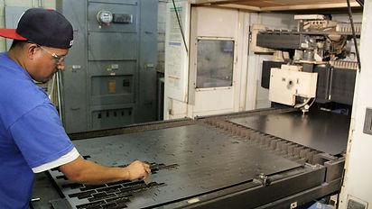 Laser operator manufacturing sheet metal parts