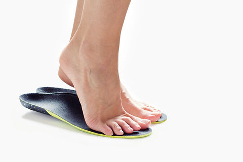female feet stand on their toes in ortho