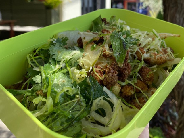 A salad in a RePlated container.