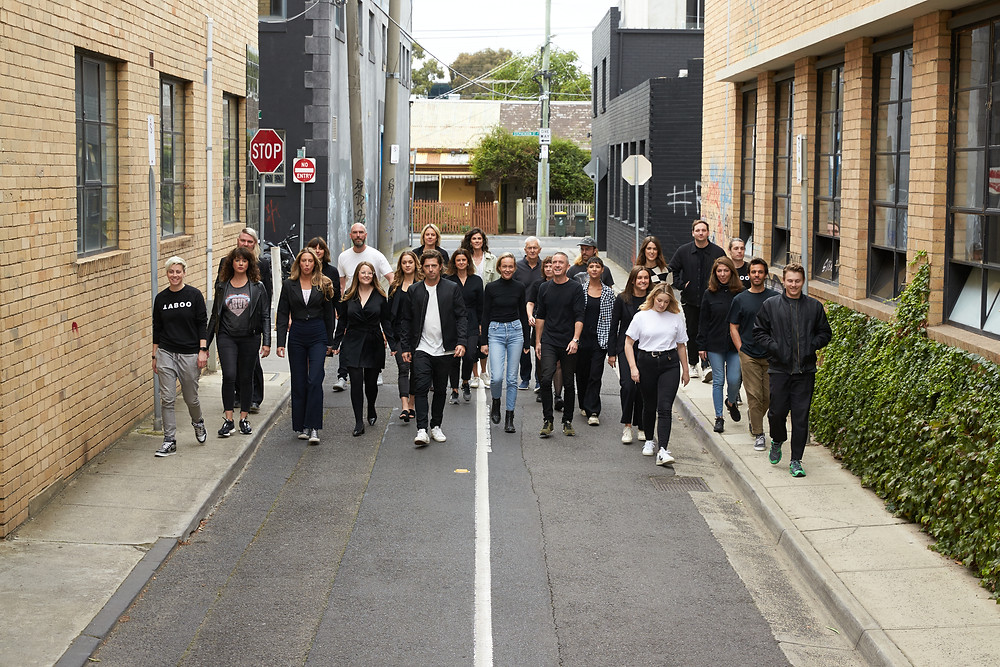 The TABOO team walks as a group in a laneway.