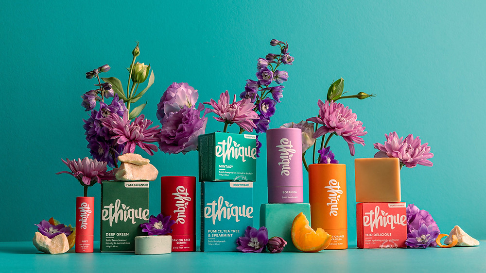 Ethique products are arranged with flowers.