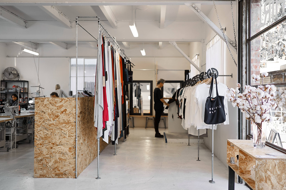 Shirts and fabric hang inside the Citizen Wolf factory.
