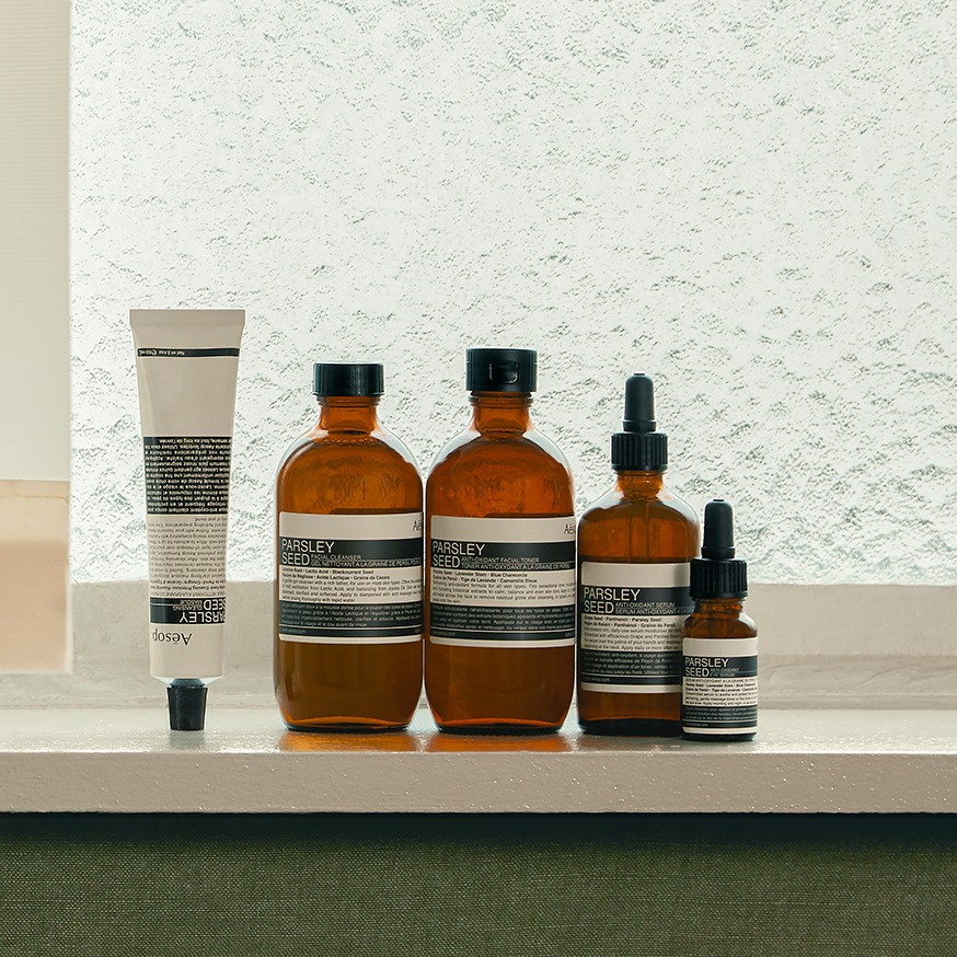 Aesop beauty products lined up on a counter.