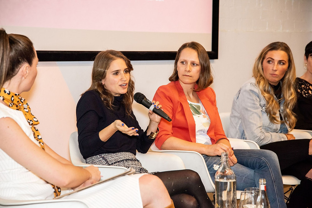 Sheree speaks on a panel of women.