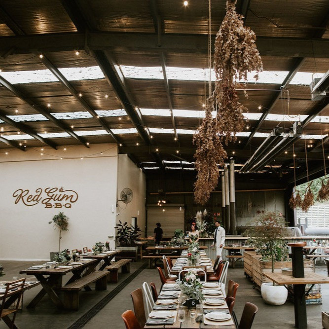 The Red Gum BBQ venue is decorated with native florals for a wedding,