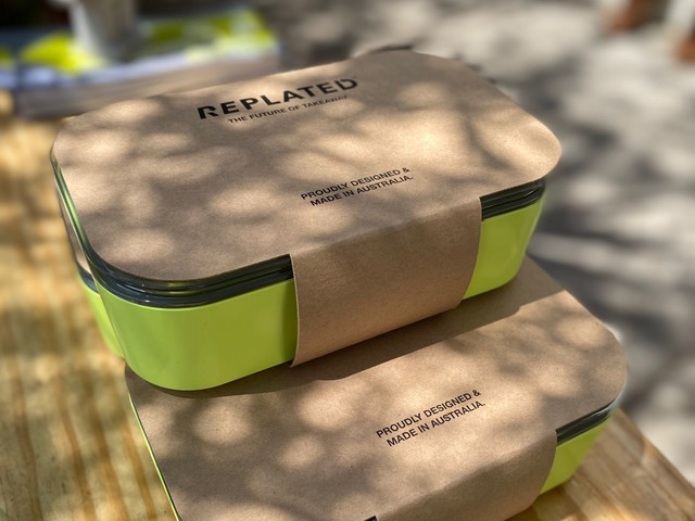 RePlated boxes stacked on a table with a label reading 'The future of takeaway. Proudly designed & made in Australia.'