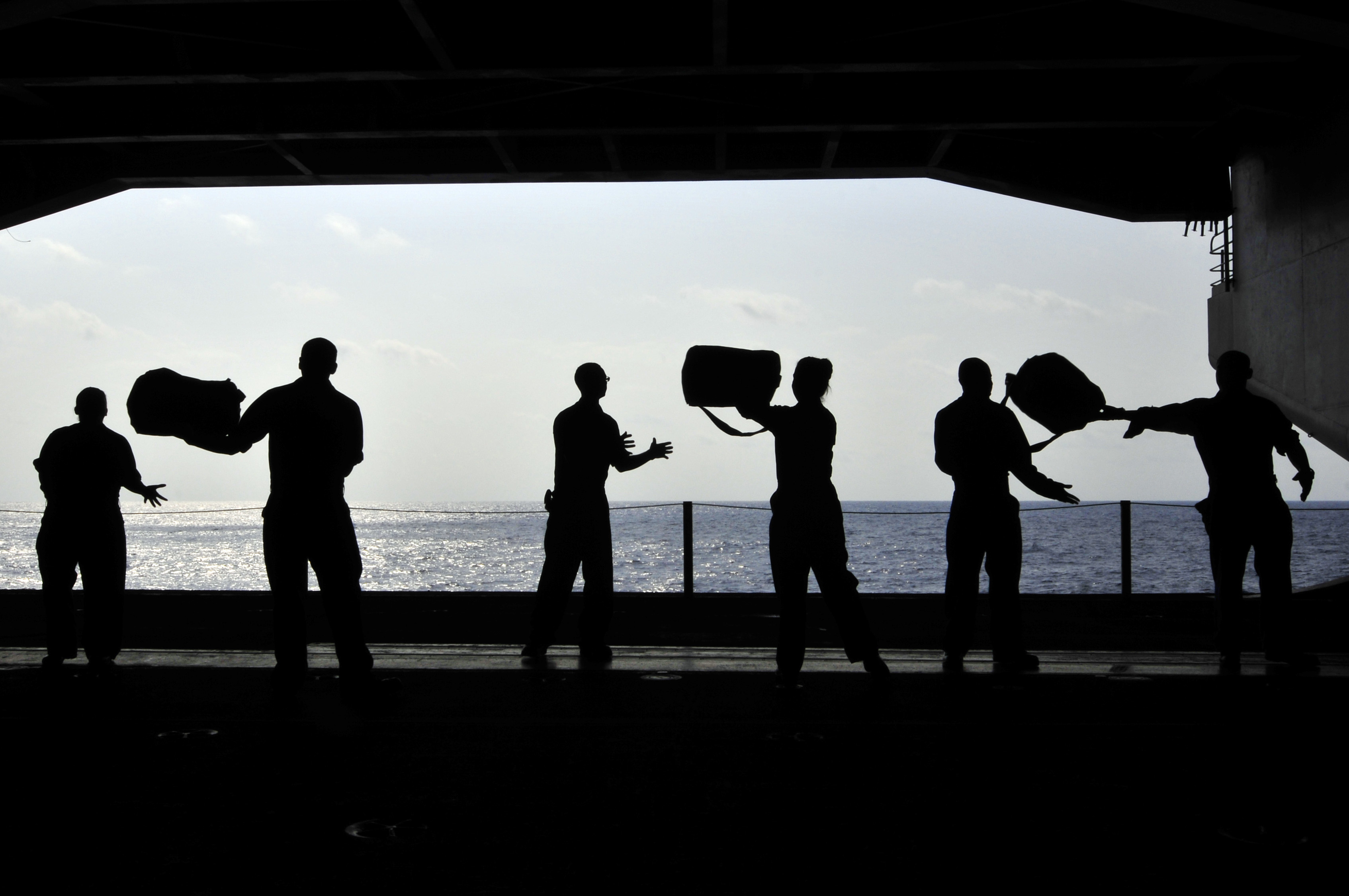 US_Navy_110414-N-DM338-087_Sailors_pass_chemical,_biological_and_radiological_kits_during_a_working_