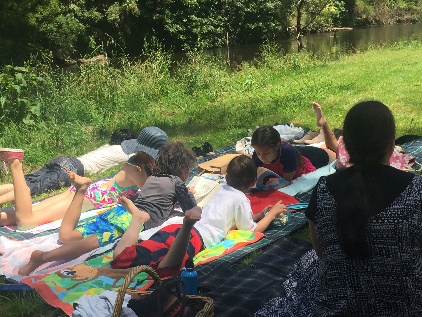 READING BY THE RIVER