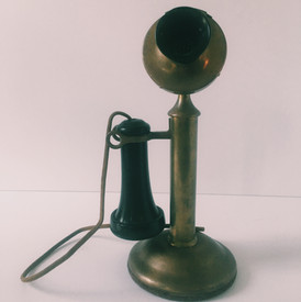 Invented in 1876, telephones were typically only found in wealthy households due to the price. This specific model, manufactured by Western Electric in 1915, is timeless and well maintained. From 1881 to 1996 the company served as a chief supplier to AT&T and is responsible for many cellular advancements. By 1920, Western Electric produced around 90% of the telephone supplies used in the United States. This 1915 telephone model is referred to as a Candlestick Telephone, due to its shape. The telephone is located in the hallway on the second floor.
