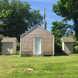 Boys and Girls Outhouses: On either side of schoolhouse