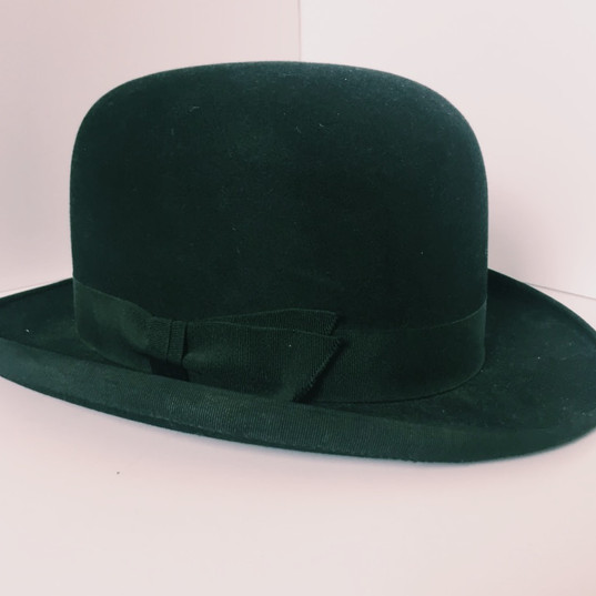 The bowler hat was designed in 1849 by Thomas and William Bowlers, hat makers from the iconic Lock and Co. hat store on St James's street in London. The hat was designed to protect gamekeepers from low hanging branches, when they were out riding. The bowler hat was created for the younger brother of the 2nd Earl of Leicester, Edward Coke, who was said to have stomped on the crown twice to check its durability, before paying for it. The bowler hat soon became a fashion statement, gaining ground in the US in the 19th century among men. Some iconic bowler hat wearers include Sir Winston Churchill, Charlie Chaplin, and Samuel Parrish. The Bowler Hat is located in Samuel Parrish's Bedroom on the second floor.