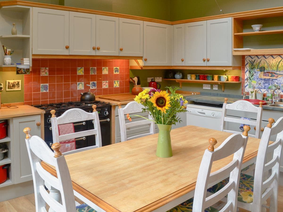 Kitchen with flowers on the table at rusko house