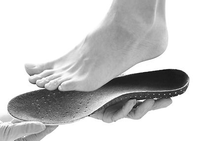 _orthopedic%20insole%20in%20the%20hands_