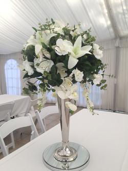Silver vase with flower arrangement