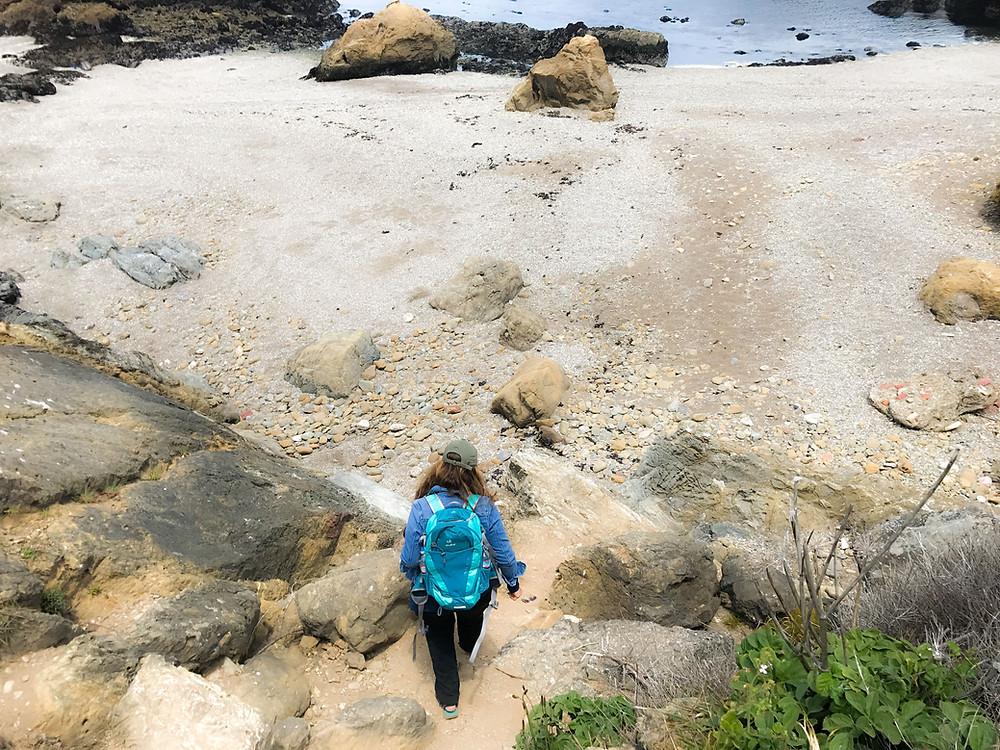 woman walking on Glass Beach