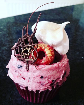 Vanilla cupcakes, with a blackcurrant buttercream, mini meringue, chocolate work, raspberry and blackberries.jpg
