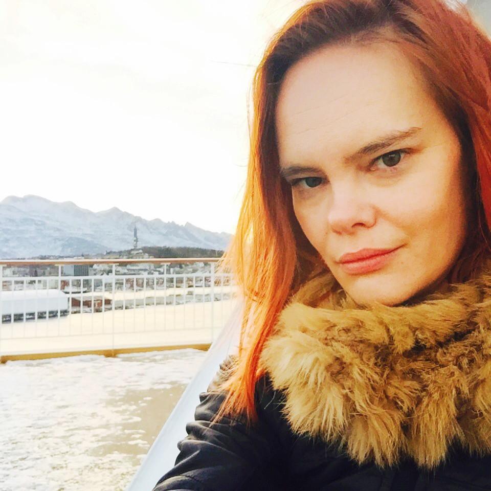 (selfie with Norwegian mountains in the winter by Erin Clark. On board the Trollfjord. Jan 2016)