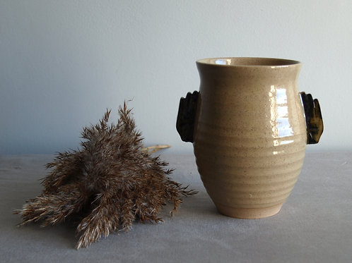 Curved hand vase