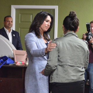 Tulsi reaches out to a supporter at townhall, March 2019