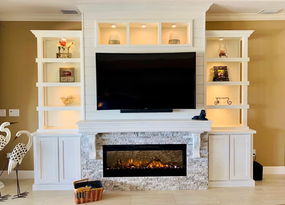 Stacked stone fireplace with built-in cabinets