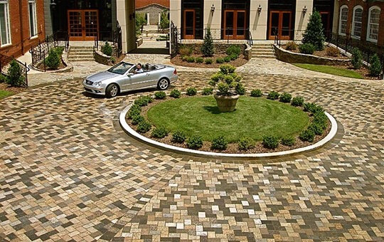 A country club with recycled granite paver driveway