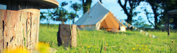 A glamping tent on a sunny summer day