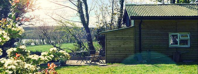 The scenic exterior of Riverside Cabin