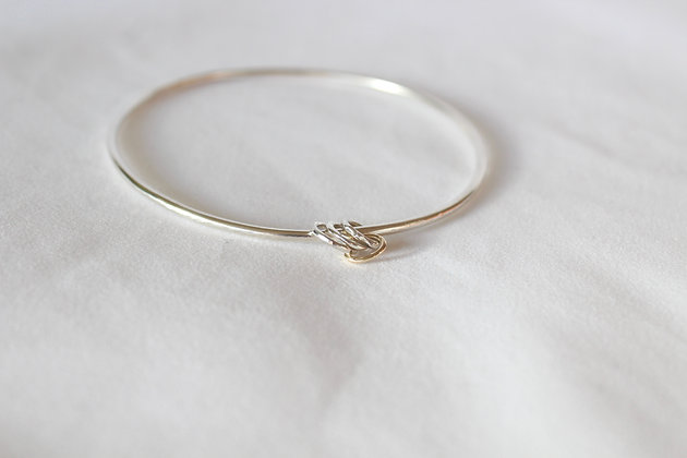 Triple ring charm bangle with 9ct.gold keeper