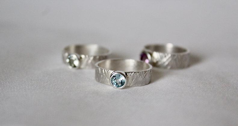 925 Sterling silver skate ring with sky blue topaz