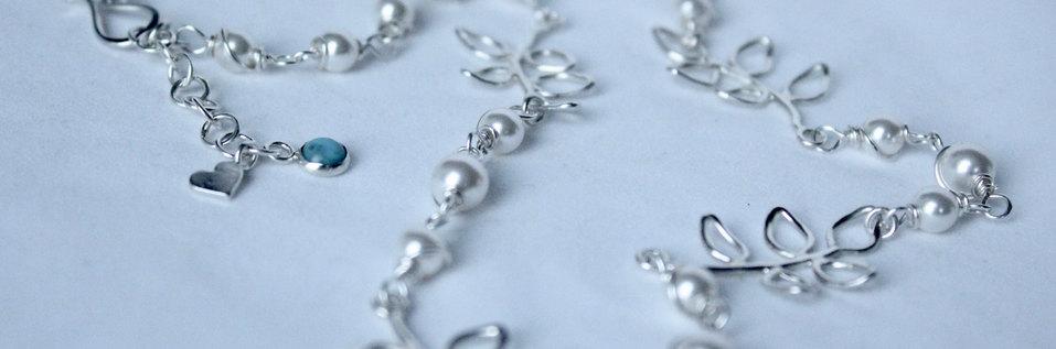 Zilveren blad-design met Swarovski® elementen