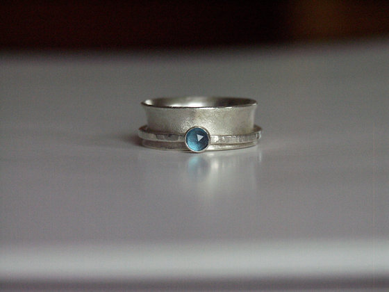 Spinner ring with London blue Topaz