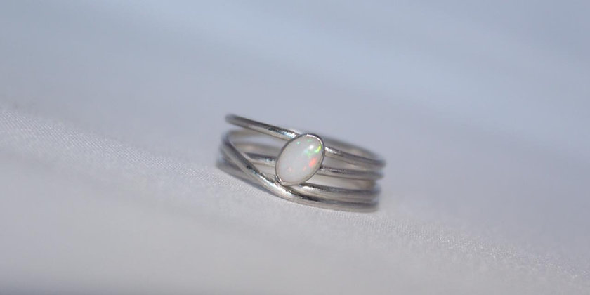 Silver wrap ring with white oval opal
