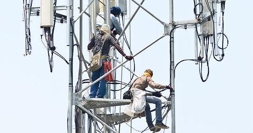 Technician-working-on-communication-towe