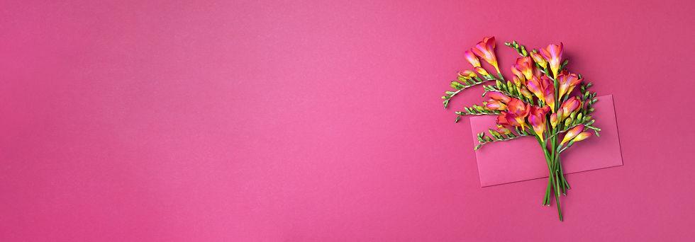 spring-freesia-flowers-on-pink-backgroun